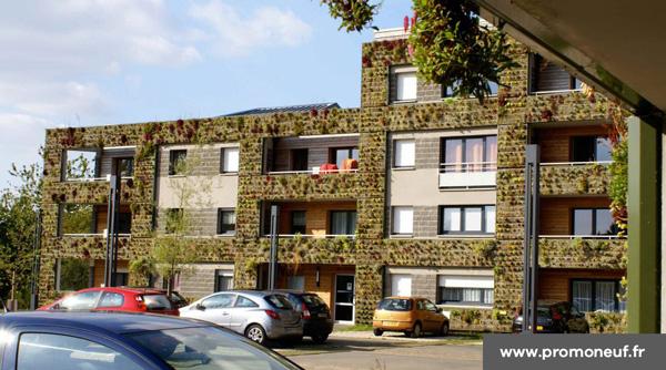 """Le bâtiment vert """"Carré Royal"""" : 71 logements"""